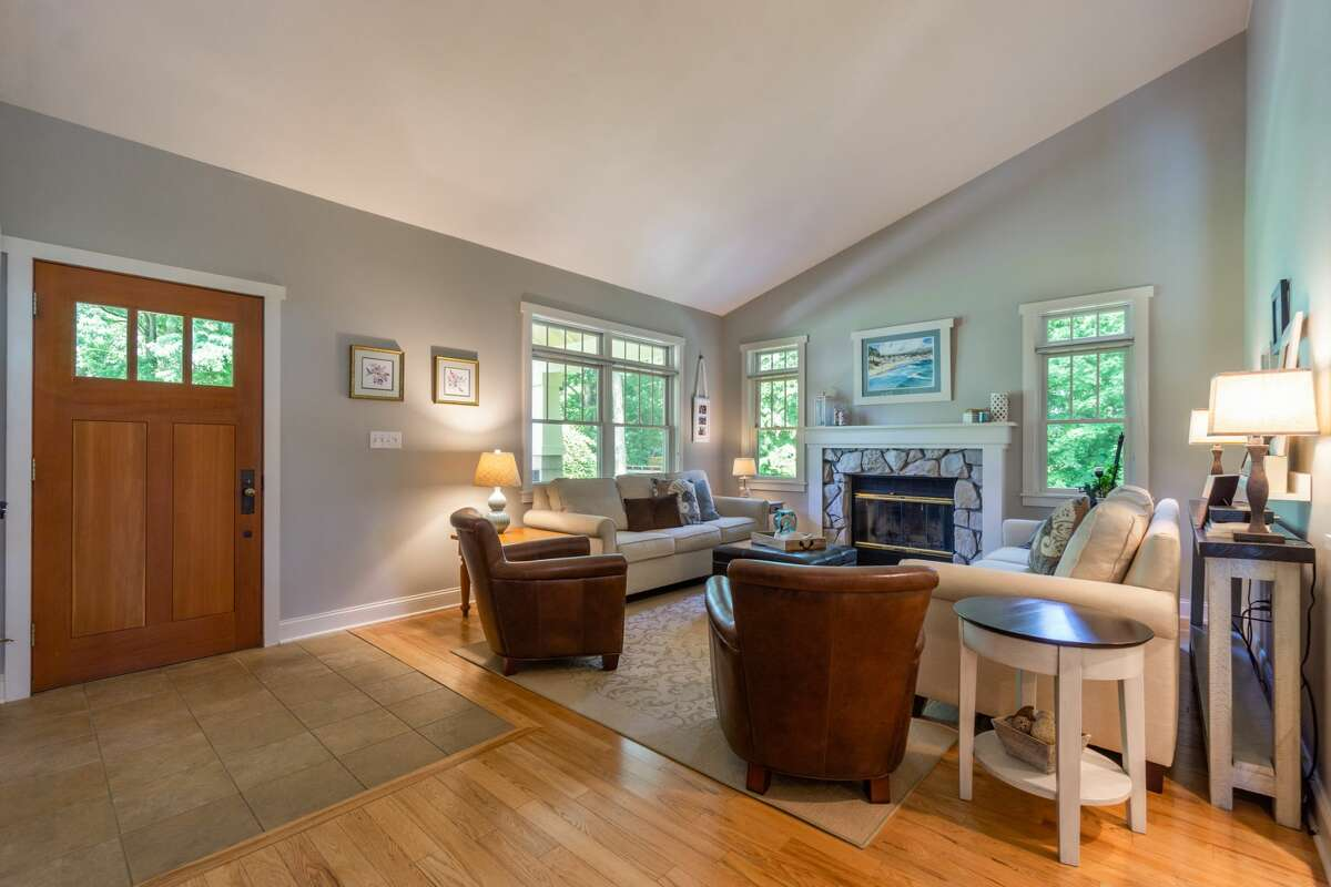 This week's selection is a home in Wilton, in the hamlet of Gansevoort. Built in 2000, the one-floor home at 16 Kings Road has a deep porch inspired by Arts and Crafts style architecture and an open layout inside. There are three bedrooms and two bedrooms in the main house and another bedroom and bathroom in a guest cottage on the 1.42-acre property. The main house has 3,100 square feet of living space. Highlights include a stone fireplace and a screened deck in the back, as well as landscaping replete with stonework and perennials. The property also includes an in-ground pool and a garage. Saratoga Springs schools. Taxes: $5,499. List price: $859,000. Contact listing agenct Dona Federico of Select Sotheby's International Realty at 518-421-6753.