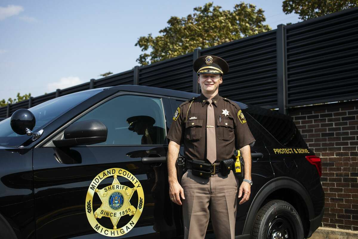 Midland County Sheriff Myron Greene poses for a portrait in front of a vehicle featuring the department's new logo Tuesday, Sept. 14, 2021 at the Law Enforcement Center. (Katy Kildee/kkildee@mdn.net)