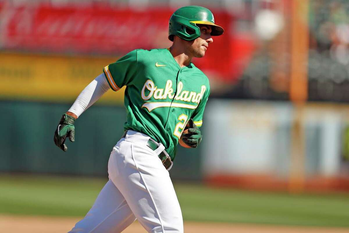 Oakland Athletics' Matt Olson rounds the bases after hitting a 2-run home run in 6th innings against Texas Rangers during MLB game at Oakland Coliseum in Oakland, Calif., on Sunday, September 12, 2021.