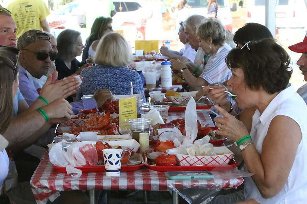 The Westport Rotary Club's LobsterFest is returning on Saturday, to Compo Beach in the town, with fun, food, and new safety measures, and added health precautions, amid the coronavirus pandemic. A previous lobsterfest event is shown.