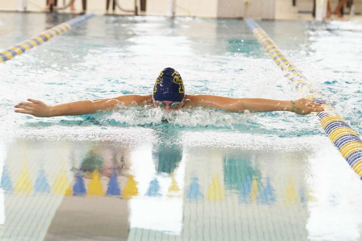 Manistee's Brooklyn Blair competes at a swim meet in 2020.