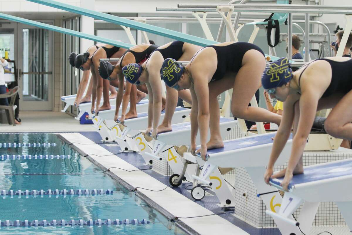 The Manistee girls swim team faces off against Fremont last year.