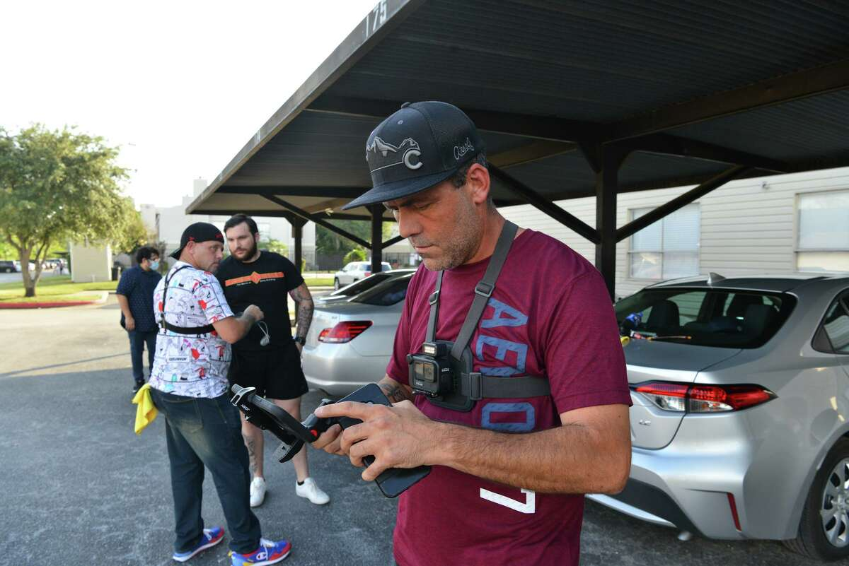 Colorado Ped Patrol founder Tommy Fellows sets up his camera to livestream as he prepares to confront a suspected pedophile identified by his group. Colorado Ped Patrol is a nonprofit dedicated to exposing potential child sex offenders.