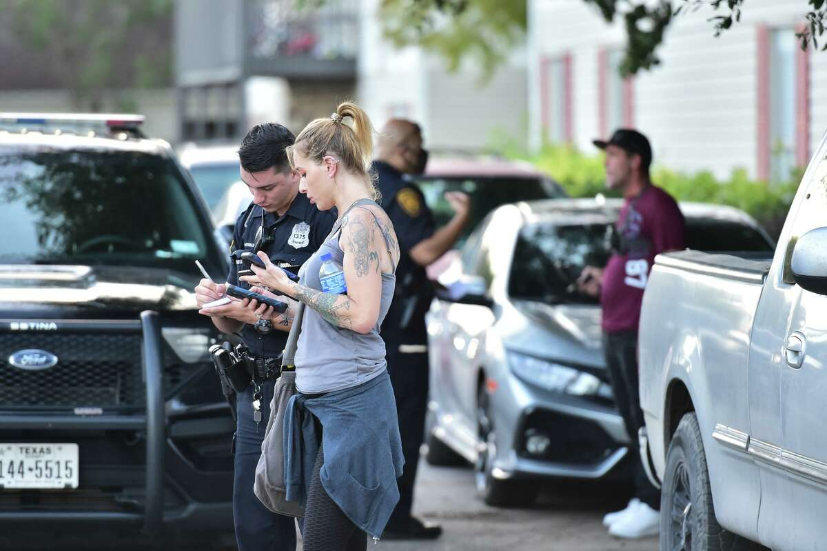 Colorado Ped Patrol volunteer Celeste Hilton speaks with a San Antonio police officer about the lewd text messages she received from a suspected pedophile as she portrayed a 13-year-old.