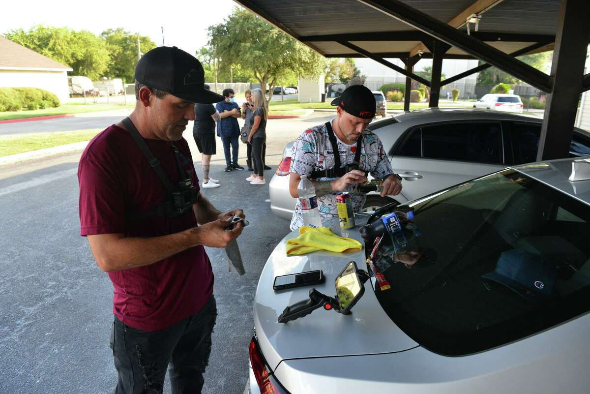 Colorado Ped Patrol founder Tommy Fellows and volunteer Dan Jones prepare livestreaming equipment before confronting a suspected pedophile while visiting San Antonio recently. Colorado Ped Patrol is a nonprofit that seeks to expose potential child sex offenders.
