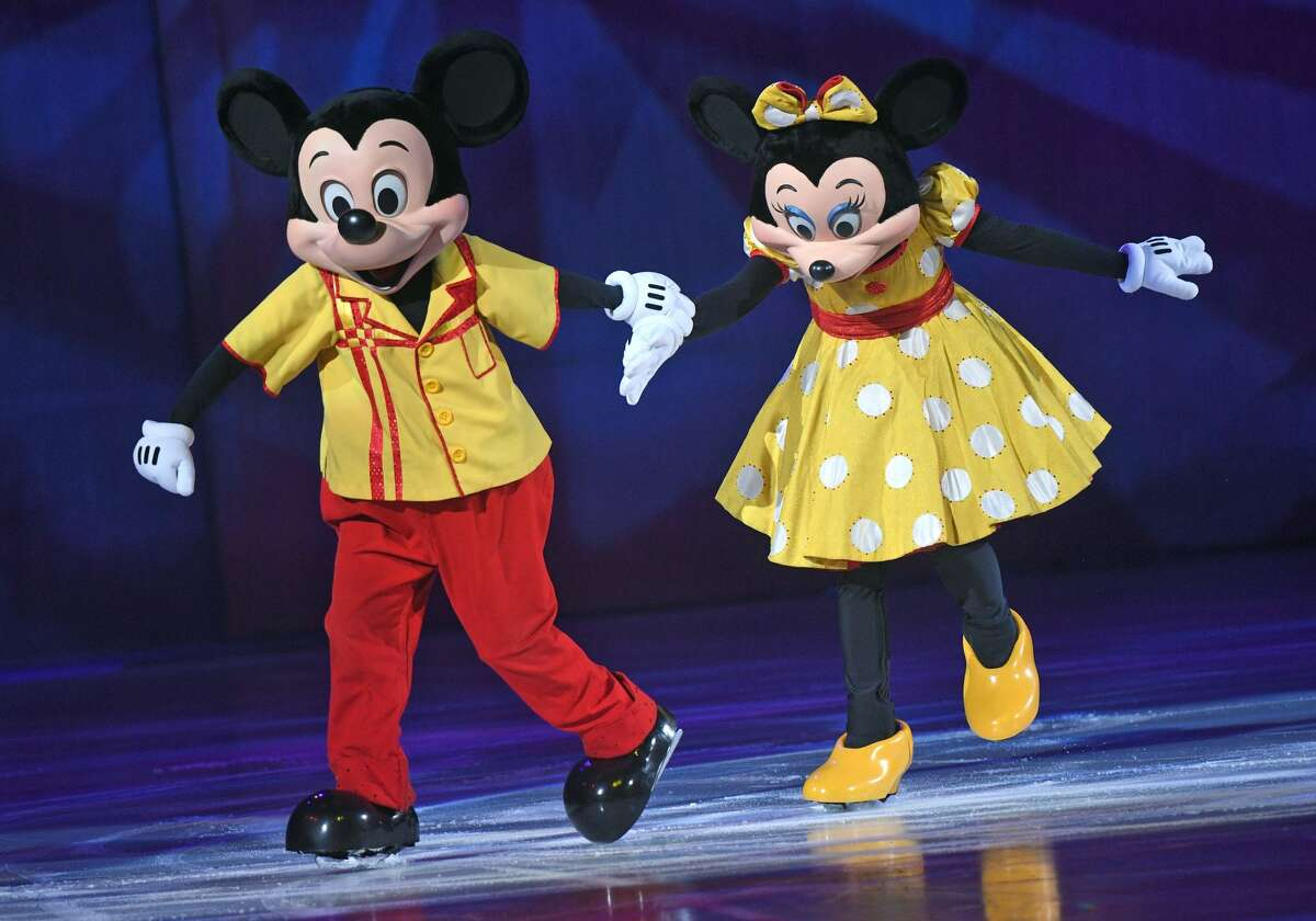 Ice-skaters dressed as Mickey Mouse and Mini Mouse can be seen on the ice during the ice dancing show 'Disney on Ice' in the Lanxess Arena in Cologne, Germany, 04 November 2017. Photo: Henning Kaiser/dpa (Photo by Henning Kaiser/picture alliance via Getty Images)
