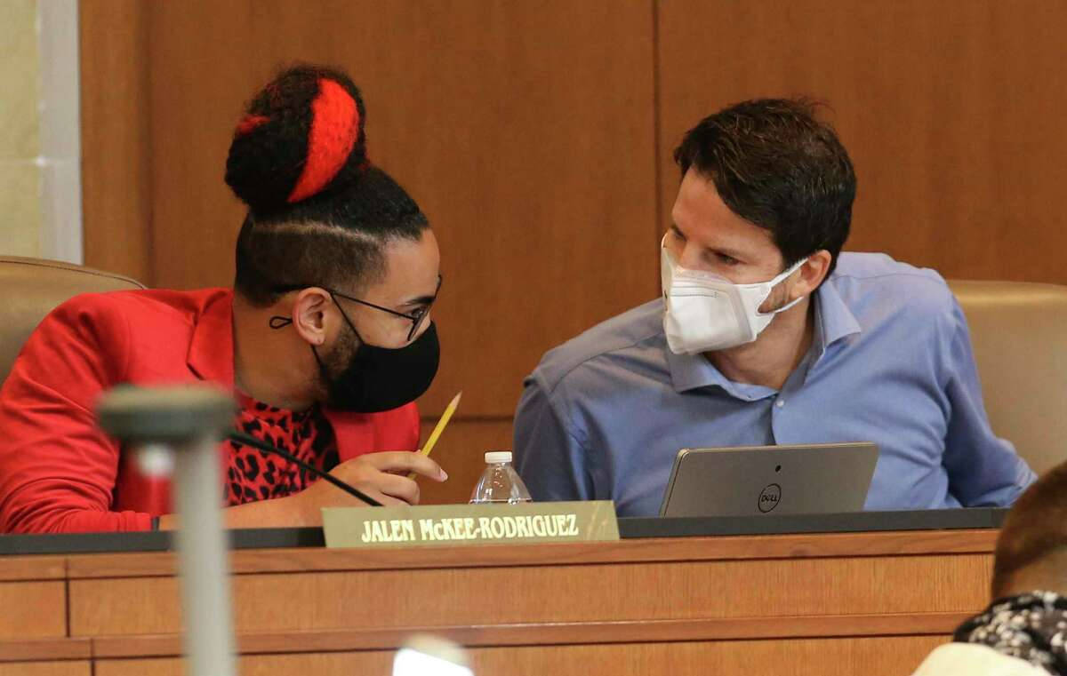 District 1's Mario Bravo (right) and District 2's Jalen McKee-Rodriguez converse as the City Council gathers for discussion and vote on the record $3.1 billion city budget on Thursday, Sept. 16, 2021.