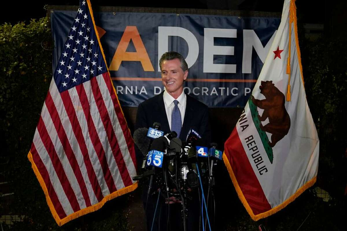 California Gov. Gavin Newsom addresses reporters after beating back the recall attempt that aimed to remove him from office at the John L. Burton California Democratic Party headquarters in Sacramento, Calif., Tuesday, Sept. 14, 2021.