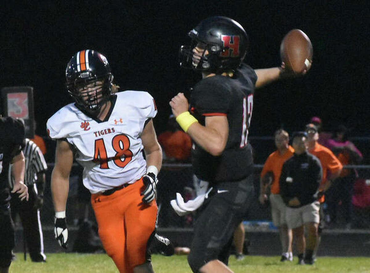 Edwardsville's Wyatt Kolnsberg pressures the Highland quarterback during Week 2 in Highland.