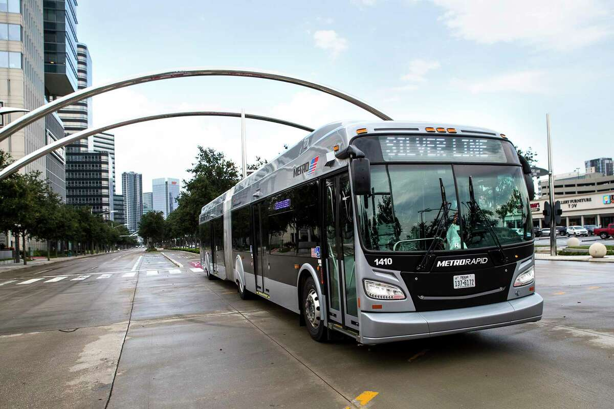 A Metro Silver Line bus rolls along Post Oak in the Galleria on Aug. 26, 2021 in Houston. Metro bus operators are required to either receive the COVID vaccine or submit to weekly testing.