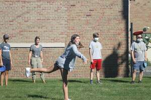 A student launches a disc during the Armory Youth Project's disc golf program on Wednesday.