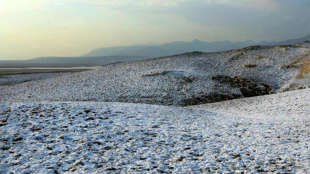 A snow-like dusting at Death Valley National Park was caused by rain soaking into the soil and dissolving salt beneath the surface, rangers said.