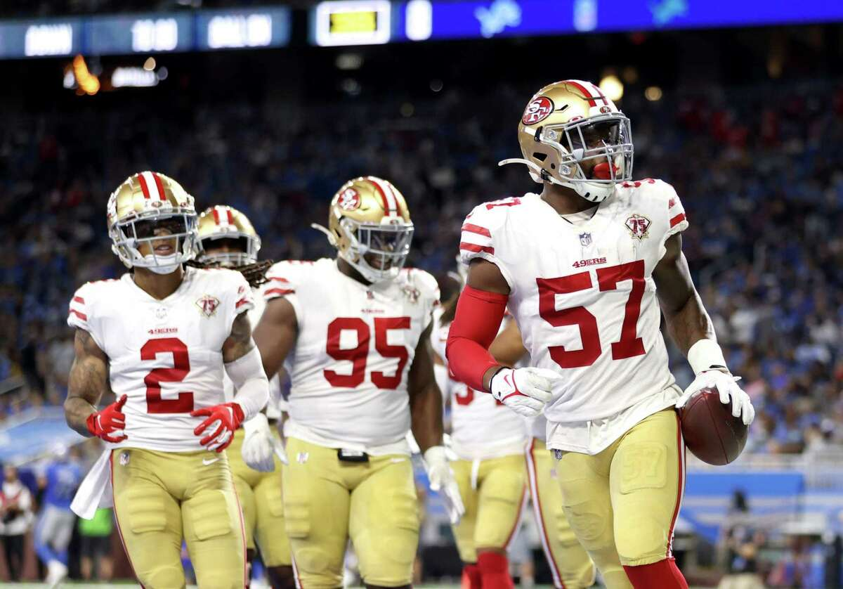 DETROIT, MICHIGAN - SEPTEMBER 12: Dre Greenlaw #57 of the San Francisco 49ers celebrates with teammates after a 39-yard interception return from a pass from Jared Goff #16 of the Detroit Lions (not pictured) during the second quarter at Ford Field on September 12, 2021 in Detroit, Michigan. (Photo by Gregory Shamus/Getty Images)
