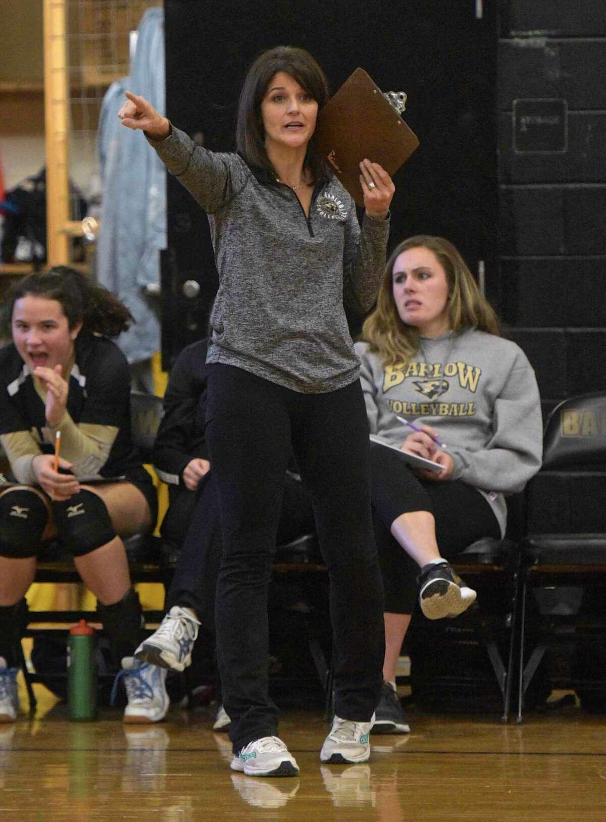 Joel Barlow head coach Carol Asplund directs her team during a girls volleyball game between Newtown and Joel Barlow high schools in 2018, at Joel Barlow High School in Redding, Conn.