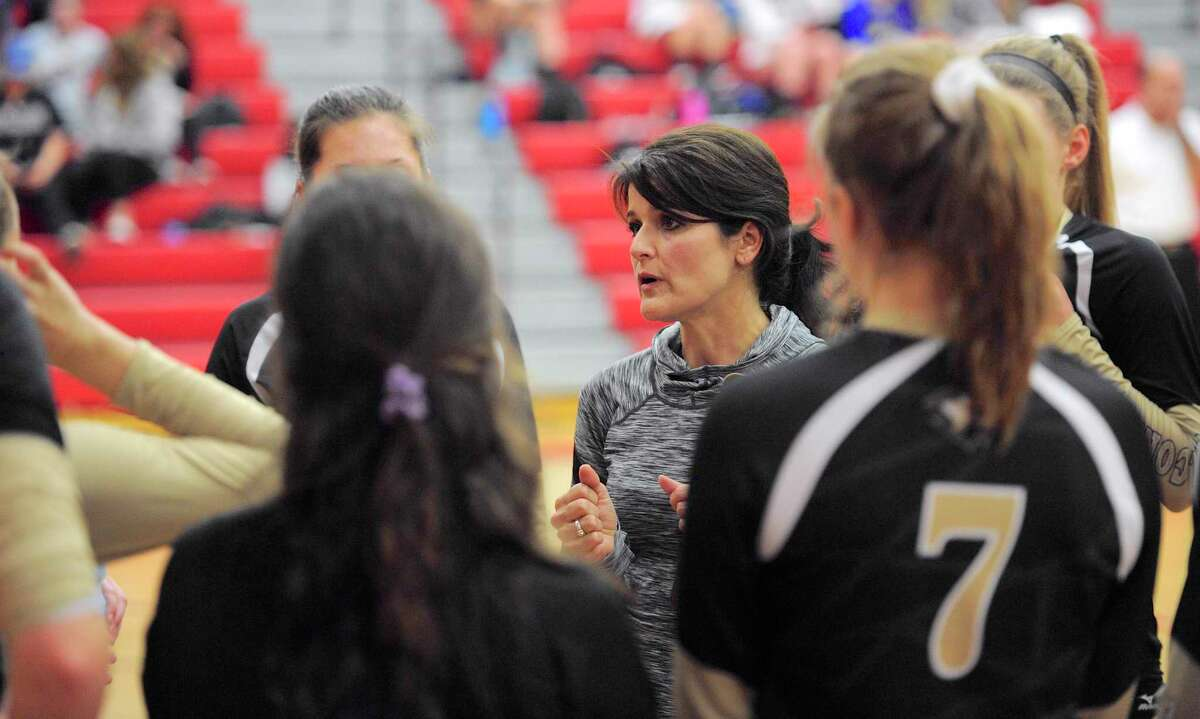 Joel Barlow head coach Carol Asplund talks to her team during a timeout in the SWC girls volleyball semifinals between Weston and Joel Barlow high schools in 2016 at Masuk High School in Monroe, Conn.