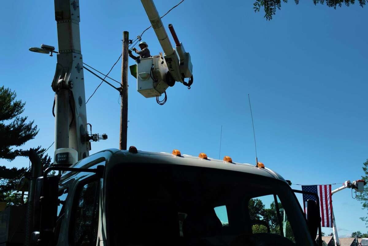 Joe Robles, a chief line mechanic for National Grid, installs a new LED street light in Hillhurst Park on on Thursday, Sept. 16, 2021, in Schenectady. National Grid is set to raise rates again in January.