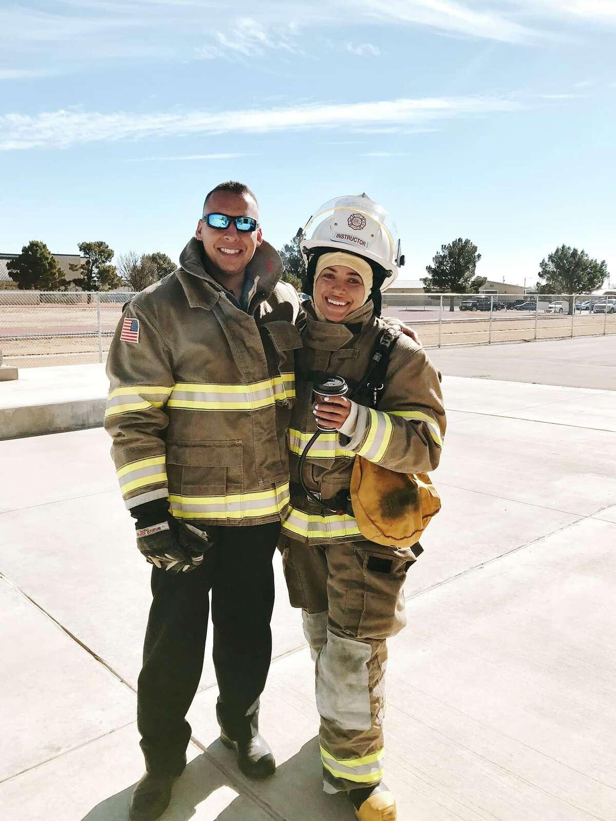 Clarke and her fiancé in firefighter gear.