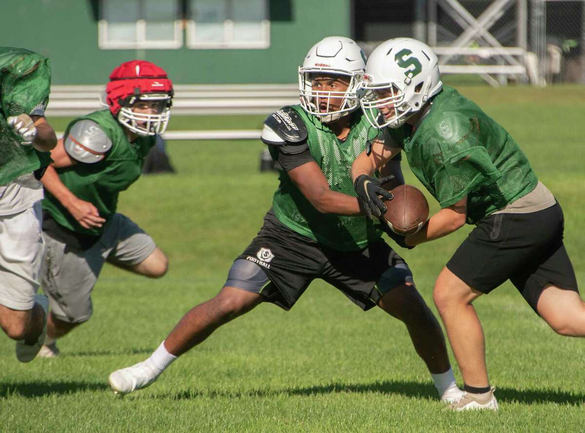 Schalmont quarterback Sean Willis hands off the football during practice with the team on Thursday, Sept. 16, 2021 in Rotterdam, N.Y.