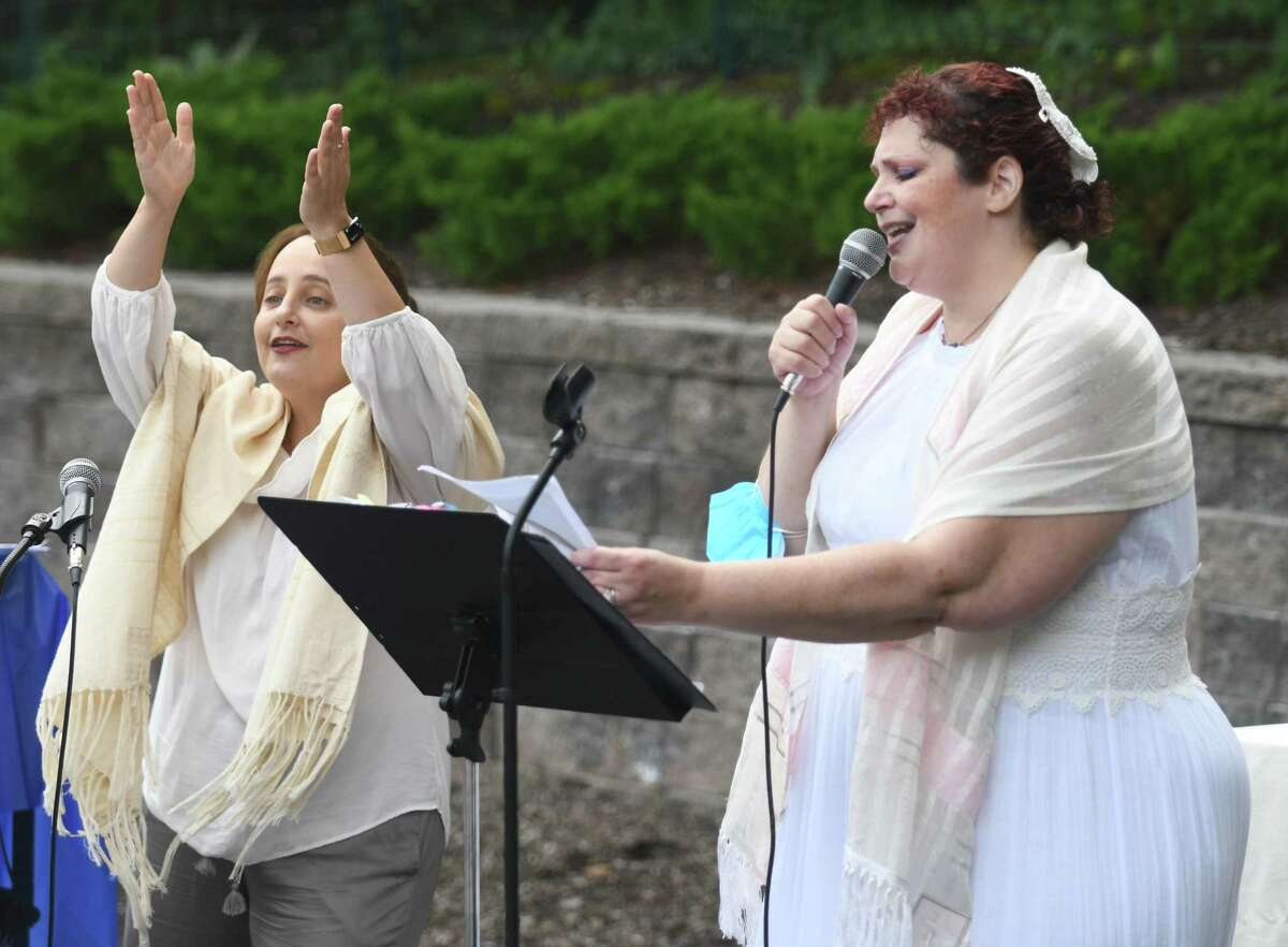 Rabbi Jordie Gerson, left, and Cantor Michelle Rubin sing during the Yom Kippur Family Service at Greenwich Reform Synagogue in Greenwich, Conn. Thursday, Sept. 16, 2021. Congregants celebrated Yom Kippur, the Jewish day of atonement, with a variety of readings and songs.