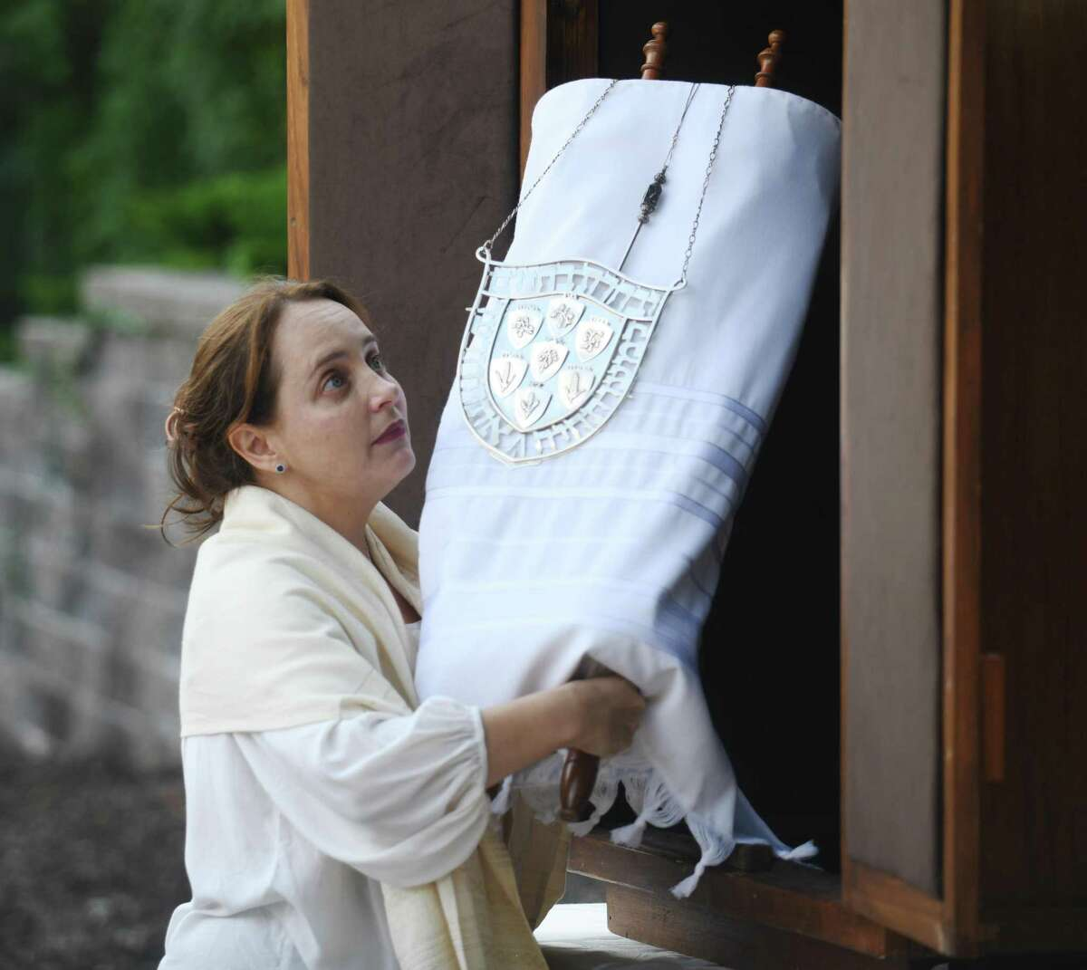 Rabbi Jordie Gerson carries the Torah during the Yom Kippur Family Service at Greenwich Reform Synagogue in Greenwich, Conn. Thursday, Sept. 16, 2021. Congregants celebrated Yom Kippur, the Jewish day of atonement, with a variety of readings and songs.