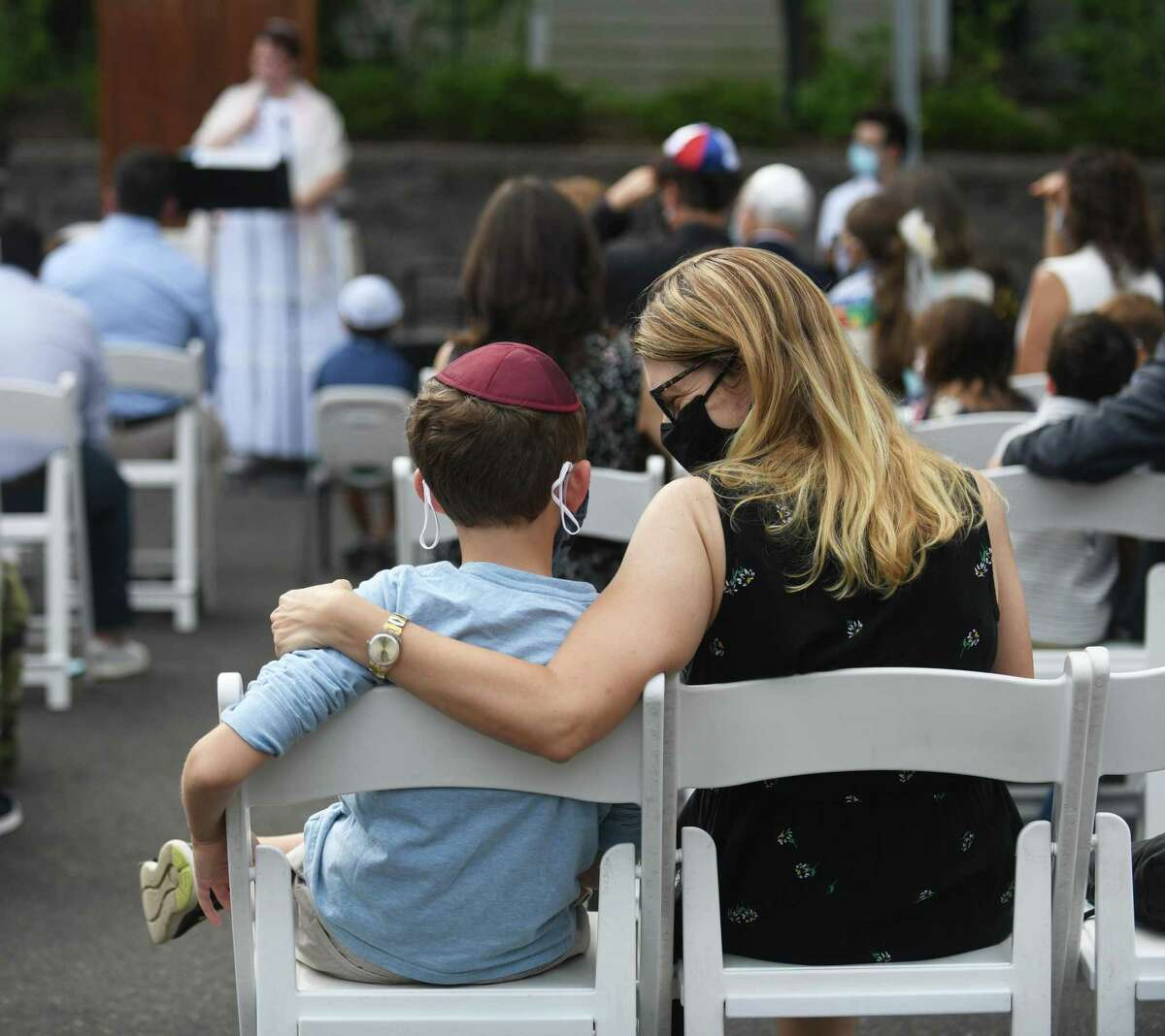 Greenwich's Karyn Schmeidler and her son, Micah, 8, attend the Yom Kippur Family Service at Greenwich Reform Synagogue in Greenwich, Conn. Thursday, Sept. 16, 2021. Congregants celebrated Yom Kippur, the Jewish day of atonement, with a variety of readings and songs.