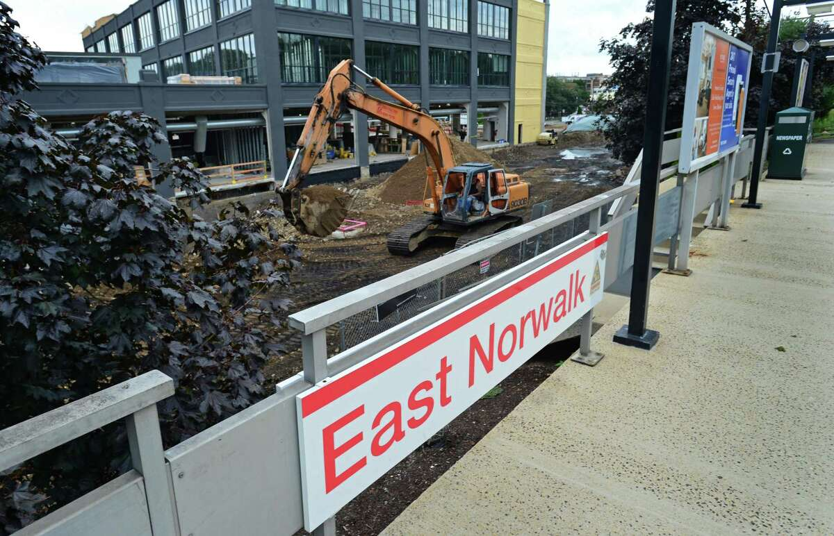 Construction continues at the Spinnaker development at the East Norwalk Train Station Friday, August 23, 2019, in Norwalk, Conn. As a part of its 10-year master plan, called the Plan of Conservation and Development, Norwalk will be focusing on building more transit-oriented-development around the train stations, improved transportation and coastal plans to combat climate change.