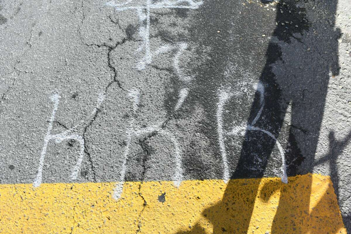 Police took a man into custody after they say he spray-painted over a Black Lives Matter mural on Lark Street on Sept. 16, 2021.