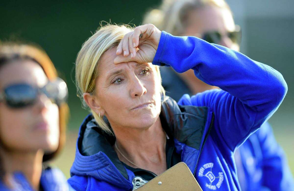 Darien coach Mo Minicus watches the game from the sidelines during an FCIAC girls field hockey rivalry match against New Canaan at Dunning Field in New Canaan, Connecticut on Saturday, Oct. 3, 2017. Darien won 2-1.