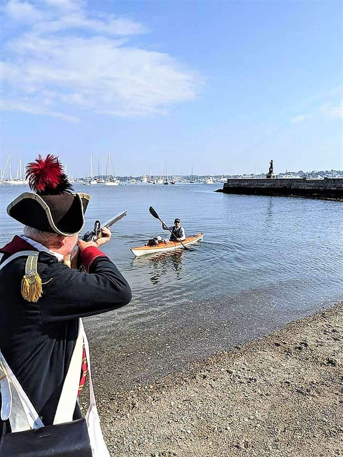 A reenactor at Newport, RI and Lilienthal in his kayak.