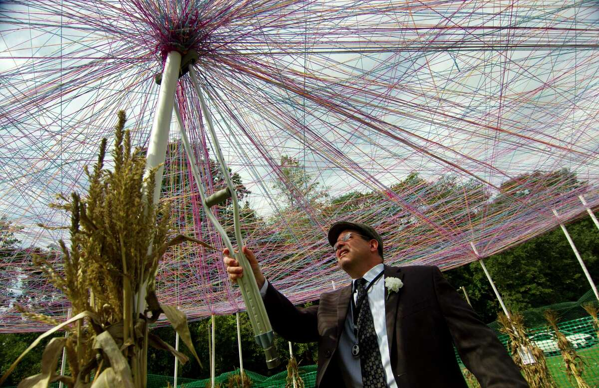 After a service for Yom Kippur, Larry Stoogenki pushes a tied piece of yard to the top of the pole at the center of a sukkah, during the building of it by the congregation of Temple Sinai Synagogue in Stamford, Conn., on Thursday, September 16, 2021. A sukkah is a temporary hut constructed for use during the week-long Jewish festival of Sukkot. Sukkot commemorates the years that the Jews spent in the desert on their way to the Promised Land, and celebrates the way in which God protected them under difficult desert conditions.
