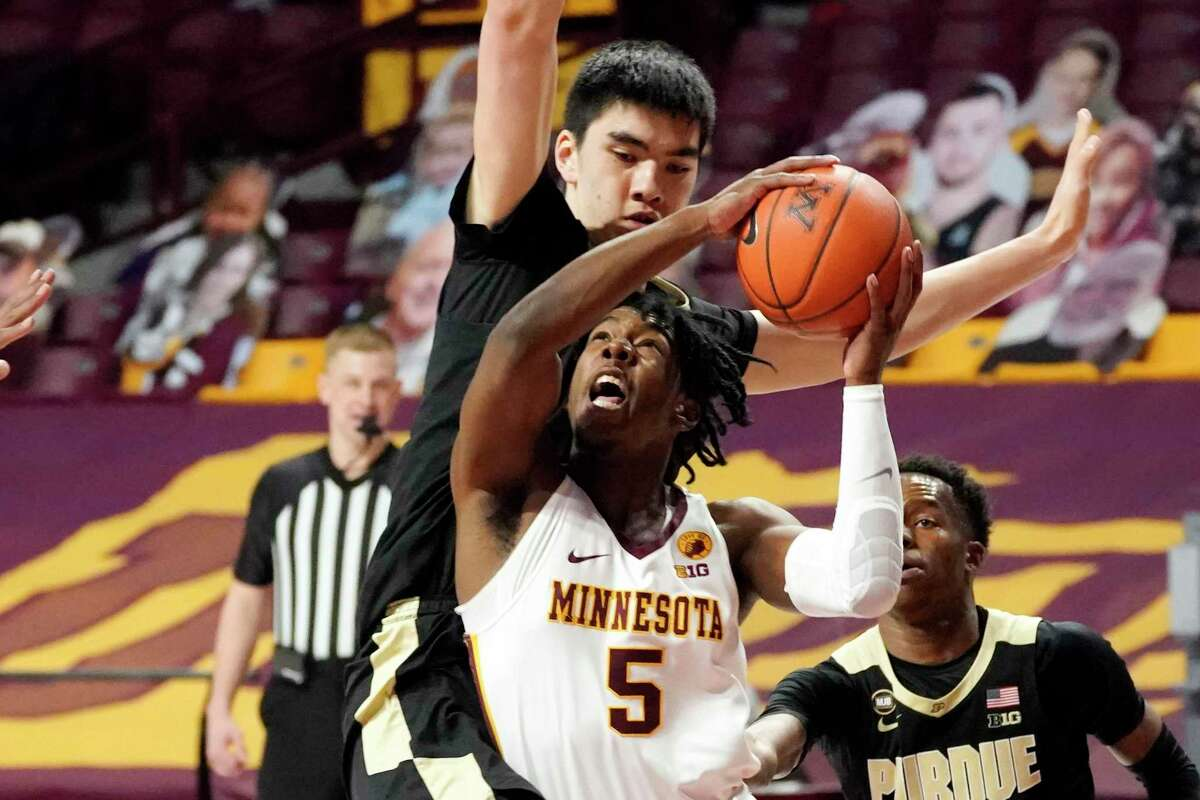Marcus Carr, center, was as an All-Big Ten performer at Minnesota who averaged 19.4 points and 4.9 assists per game. Now with Texas, the transfer guard was recently named Big 12 preseason newcomer of the year.