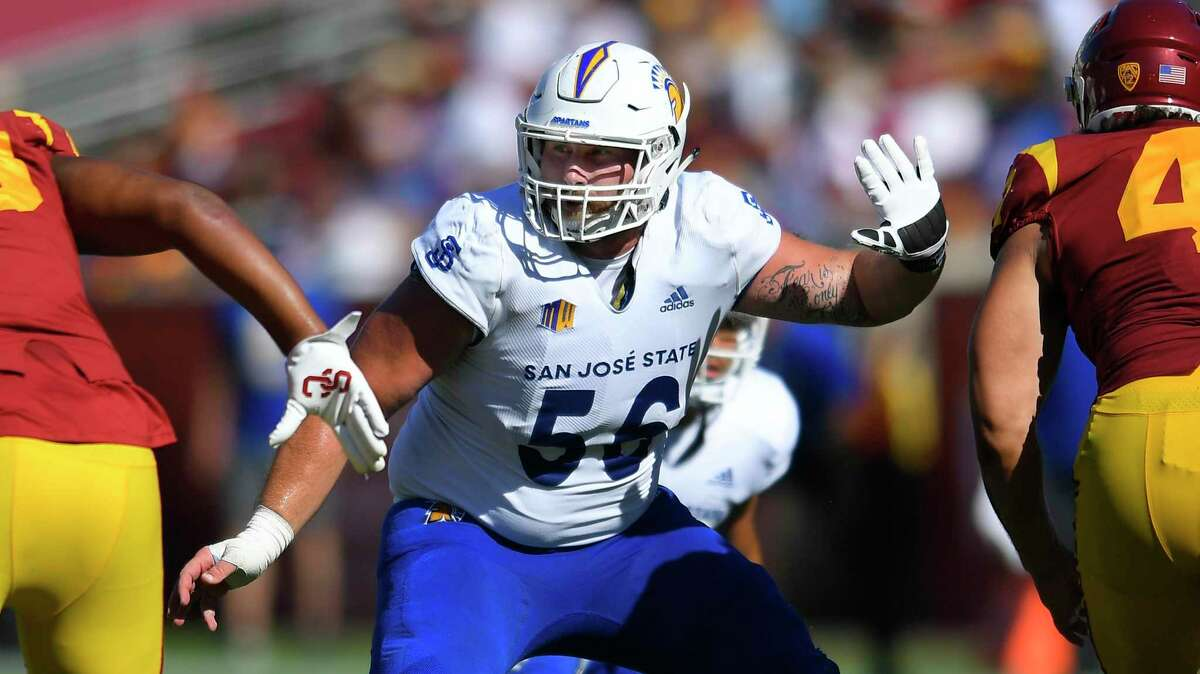 San Jose State Spartans center Kyle Hoppe guards USC Trojans defenders during an NCAA football game on Saturday, Sept 4, 2021, in Los Angeles. (AP Photo/John McCoy)