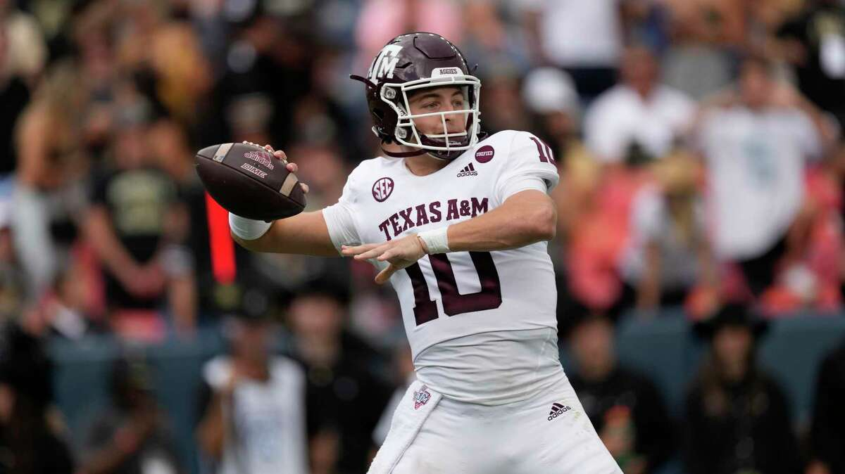 Texas A&M quarterback Zach Calzada (10) in the first half of an NCAA college football game Saturday, Sept. 11, 2021, in Denver.