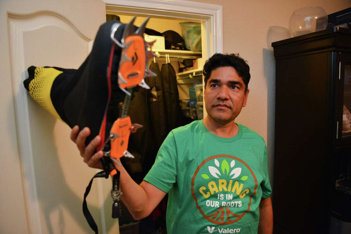 Sachi Arya shows the double boots he has used to climb mountains in Colorado and Nepal.