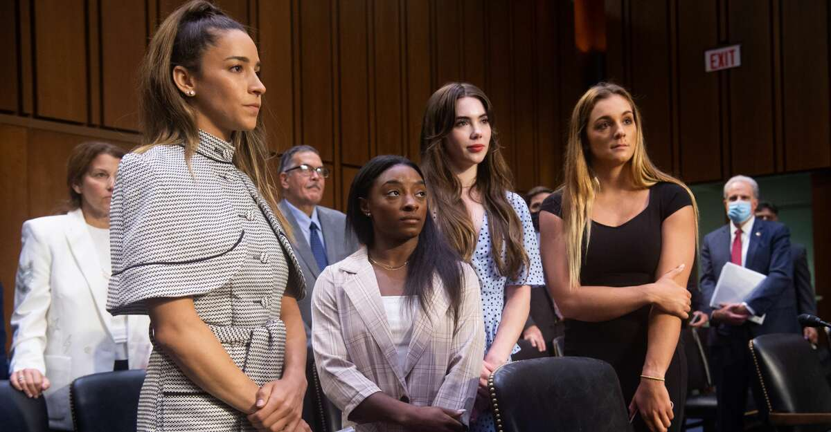 U.S. Olympic gymnasts Aly Raisman, Simone Biles, McKayla Maroney and NCAA and world champion gymnast Maggie Nichols leave after testifying during a Senate Judiciary hearing about the Inspector General's report on the FBI handling of the Larry Nassar investigation of sexual abuse of U.S. gymnasts, on Capitol Hill, September 15, 2021 in Washington, DC. (Photo by Saul Loeb - Pool/Getty Images)