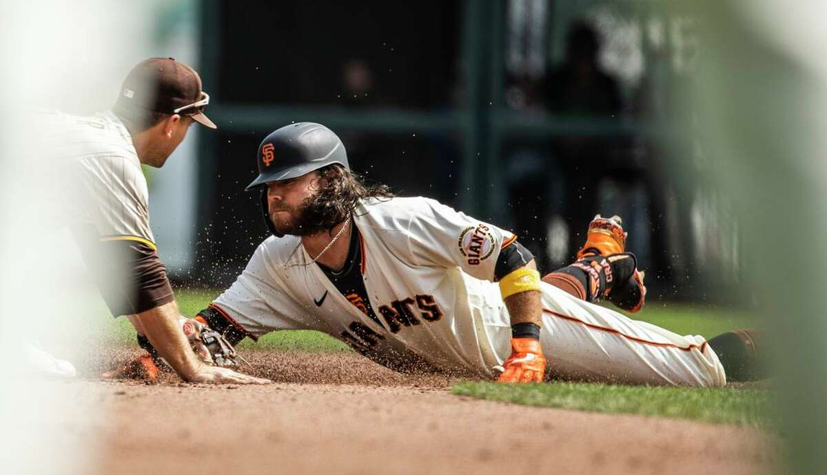 Brandon Crawford is tagged out at second by the Padres' Adam Frazier while trying to stretch a single during the fourth inning.