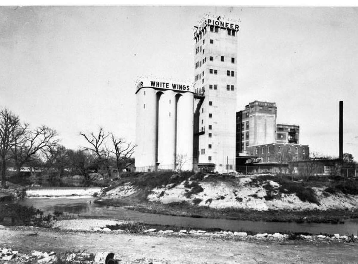 The iconic Pioneer Flour Mills grain elevator tower, as seen in 1931. The 20-story building was completed in 1922.