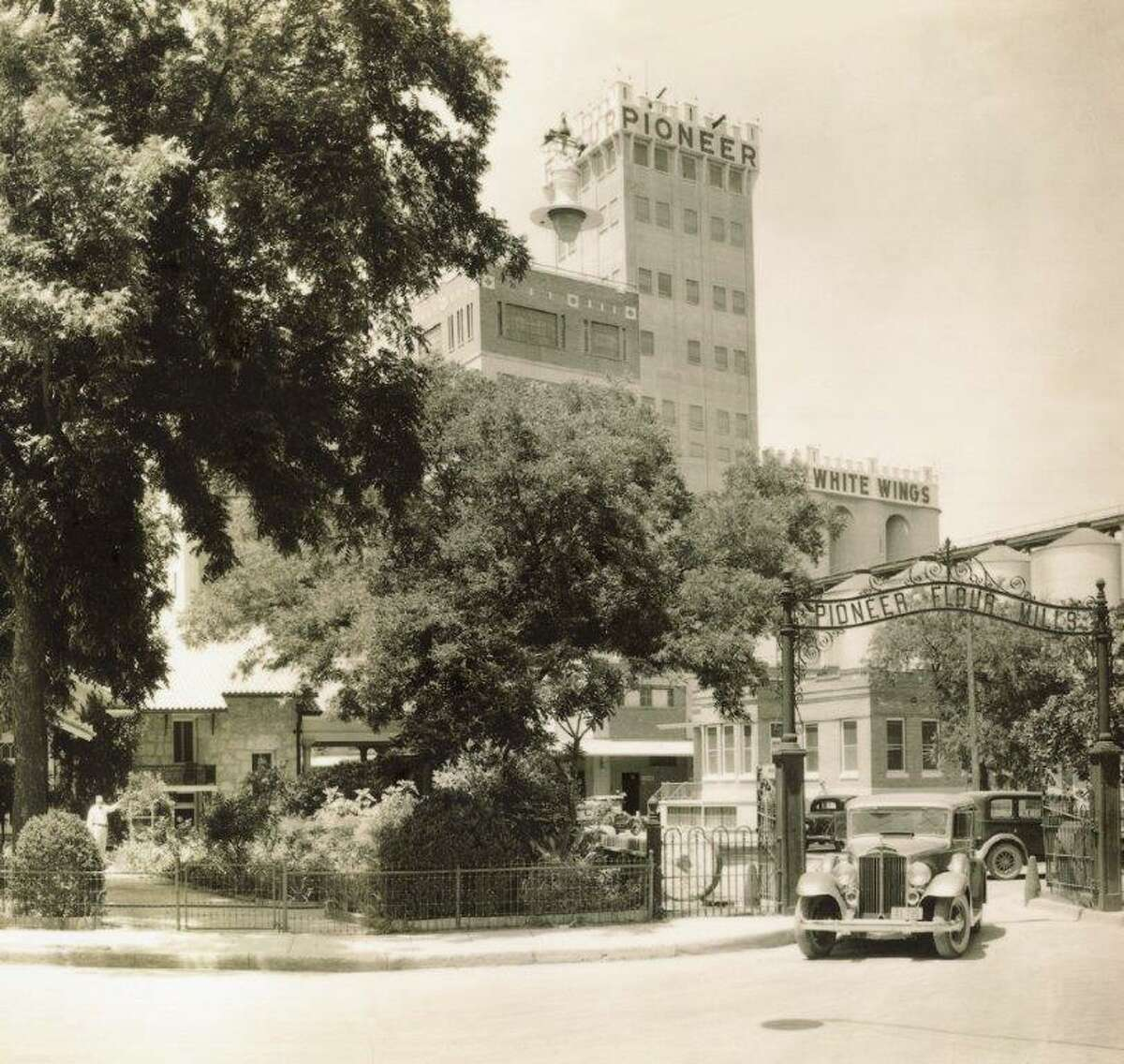 In this 1934 photo, an automobile goes through the entrance at Pioneer Flour Mills.