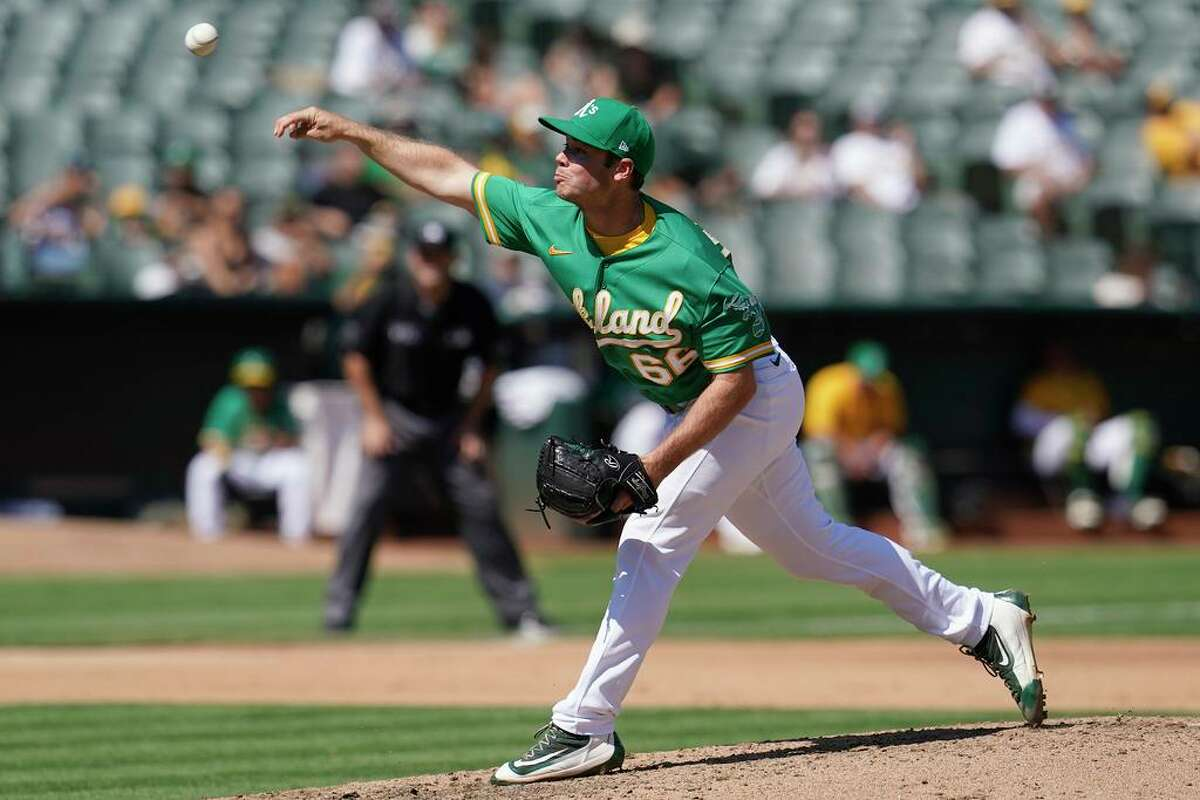 Oakland Athletics' Daulton Jefferies against the Texas Rangers during a baseball game in Oakland, Calif., Sunday, Sept. 12, 2021. (AP Photo/Jeff Chiu)