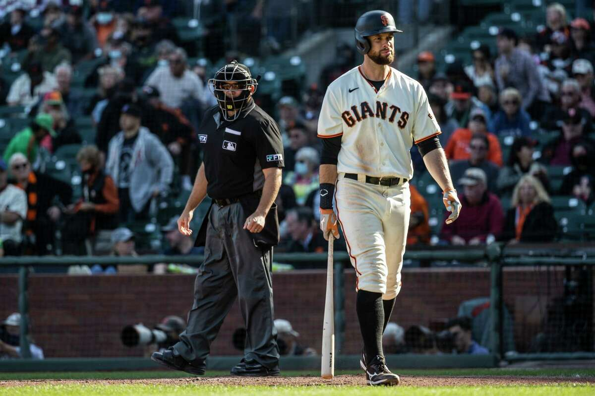 Brandon Belt came to the plate with two runners on and the Giants trailing by three but struck out to end the game.