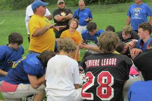 Gilbert/Northwestern/Housatonic football coach Scott Salius talks to his team after a scrimmage with Cheney Tech.