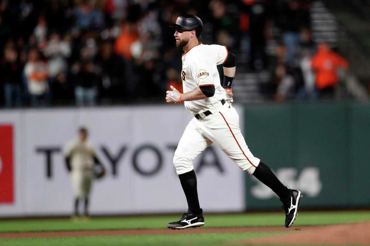 Giants first baseman Brandon Belt rounds the bases after his solo home run against the Padres on Wednesday night. Belt has a career-high 25 homers this season.
