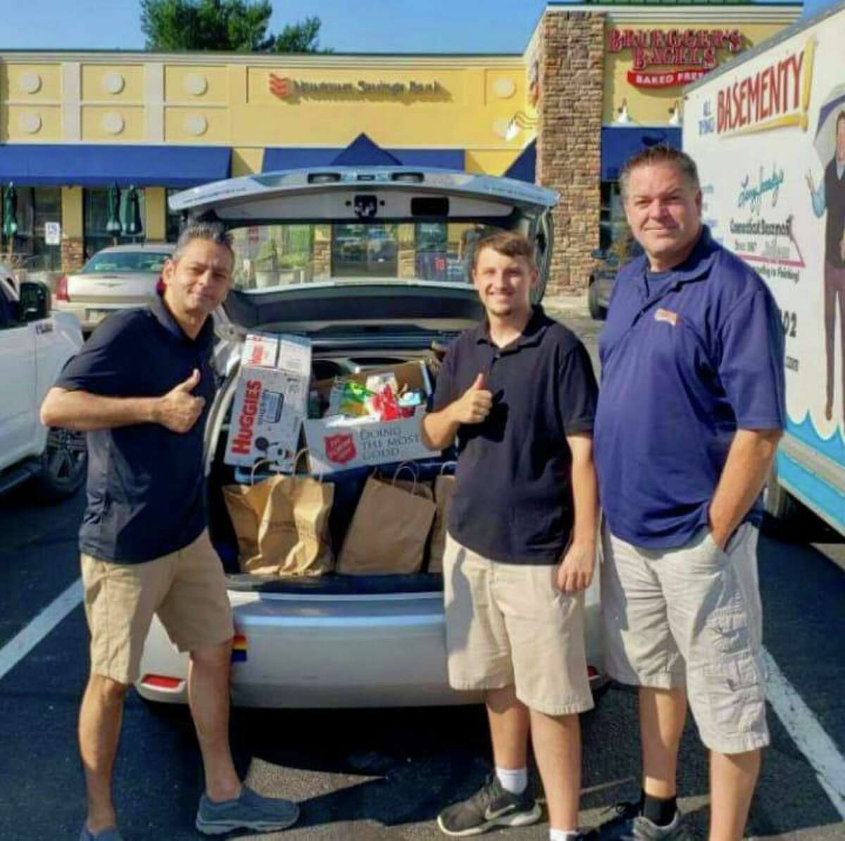 Envision Shelton Aldermen candidates David Gidwani, left, Matt McGee, center, and Chris Jones with donations - collected at a past donation drive - for the Shelton Animal Shelter. Gidwani is seeking reelection to the First Ward, while McGee and Jones are running in the Third Ward.