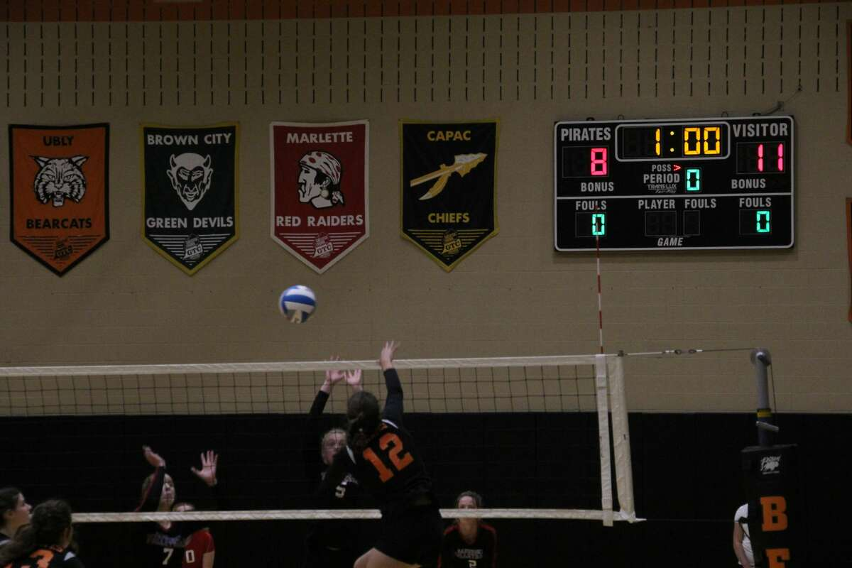 Harbor Beach's Tori Hurren spiked the ball for a kill. This sparked a 10-0 run for the Pirates in the second set.