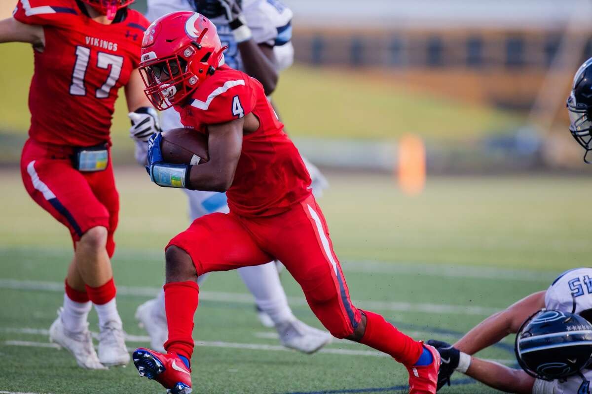 Dulles Vikings RB/DB Jalen Brown (4) runs for a first down during the first half of action between Dulles Vikings vs. Clements Rangers during a high school football game at the Hall Stadium, Thursday, September 16, 2021, in Missouri City. (Juan DeLeon/Contributor)