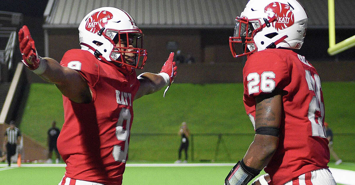 Katy running back Isaiah Smith (26) celebrates his touchdown with Antonio Silva during the second half of a high school football game against The Woodlands, Thursday, Sept. 16, 2021, in Katy.