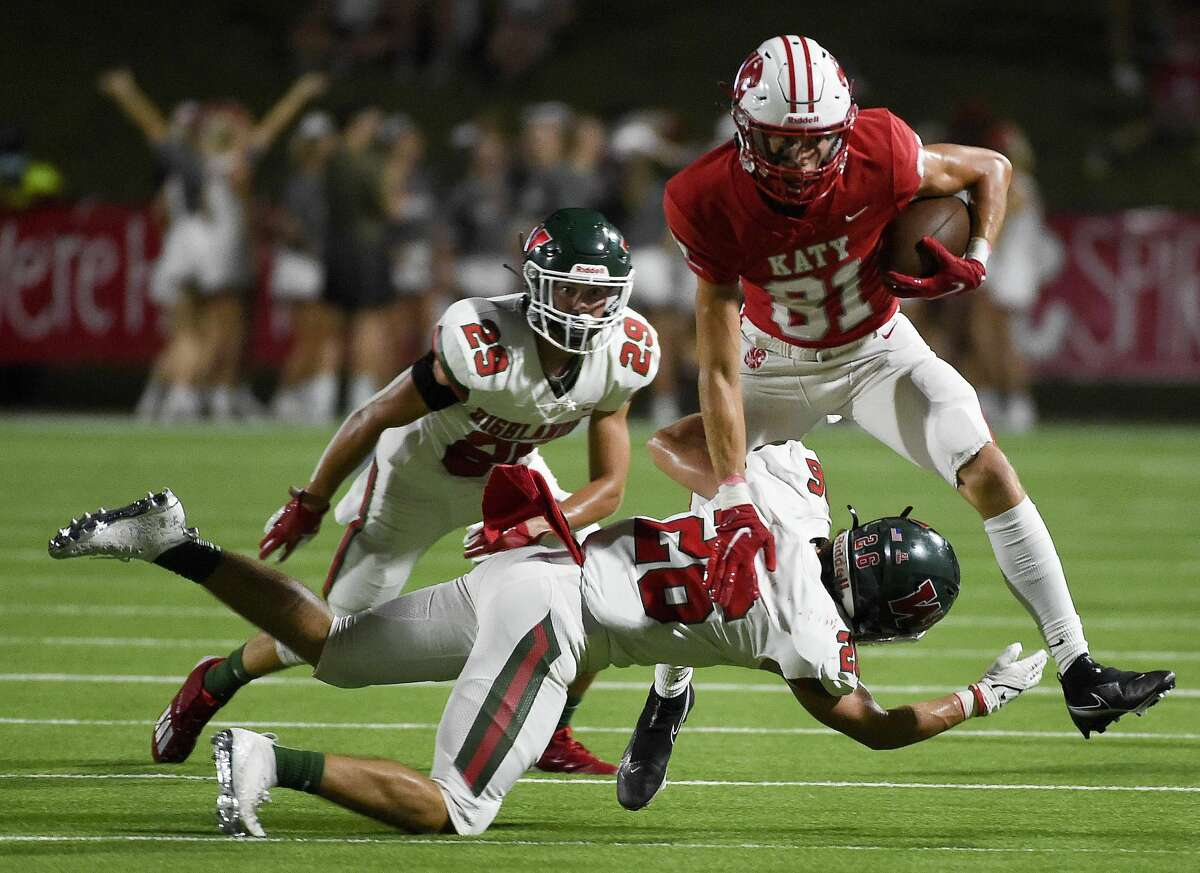Katy wide receiver JR Ceyanes (81) is tackled by The Woodlands defensive back Cooper Starcke during the second half of a high school football game, Thursday, Sept. 16, 2020, in Katy.