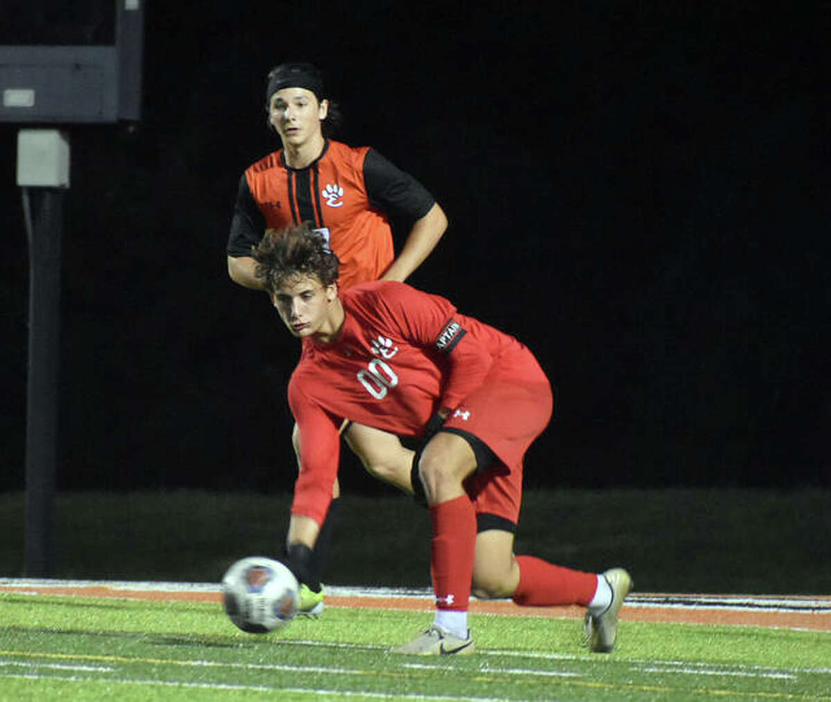 Edwardsville keeper Nathan Beck rolls a pass up the field against Belleville West during the first half on Thursday inside the District 7 Sports Complex.