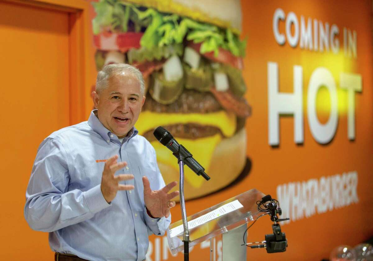 Whataburger CEO Ed Nelson speaks Aug. 24, 2021 at San Antonio International Airport during a news conference announcing Whataburger would be opening a restaurant there.