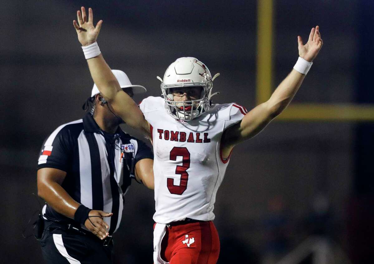 Tomball quarterback Cale Hellums (3) reacts after throwing a 17-yard touchdown pass to Hayden Oren during the second quarter of a non-district high school football game at Woodforest Bank Stadium, Thursday, Sept. 16, 2021, in Shenandoah.